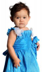 Little girl in a fancy blue dress
